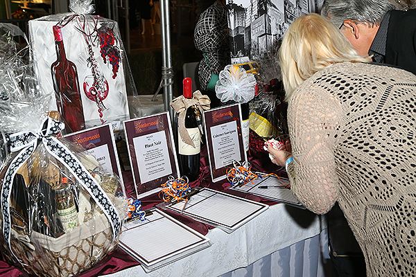 Attendees enter the lavish silent auction at Easterseals Nevada Seventh Annual Cheers to Chocolate at The Distrct at Green Valley Ranch