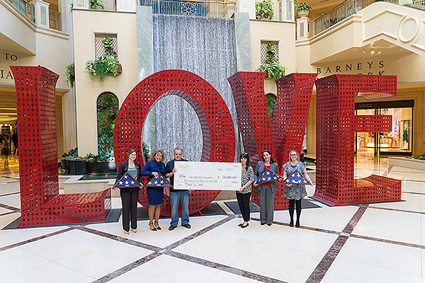 Team members from The Venetian and The Palazzo Las Vegas Present a 10000 check to Veterans Village Las Vegas CEO Arnold Stalk