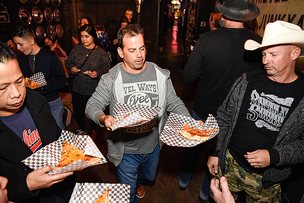 Evel Pie General Manager Joey D Amore serves up slices to guests