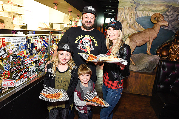 Evel Pie s Managing Partner Branden Powers celebrates with his family