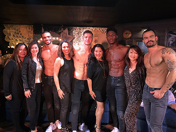 Kristi Yamaguchi Second from left poses with cast of MAGIC MIKE LIVE Dec. 3 2017