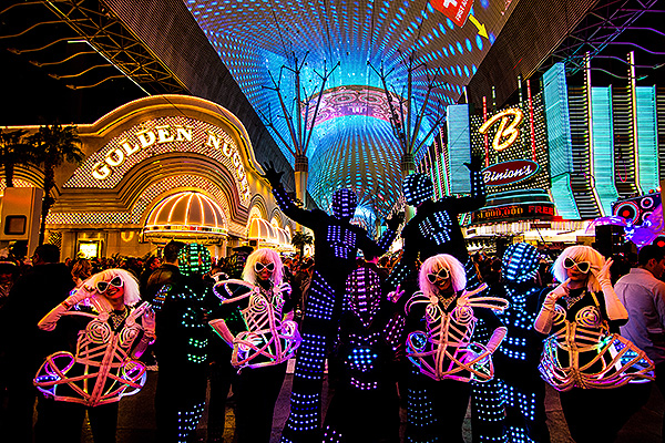 Dancers wearing LED light suits posed for photos with guests and hyped up the crowd on NYE at Fremont Street Experience 12.31.17