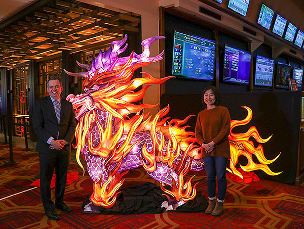 David Strow and Huiyuan Liu pose next to the kylin lantern