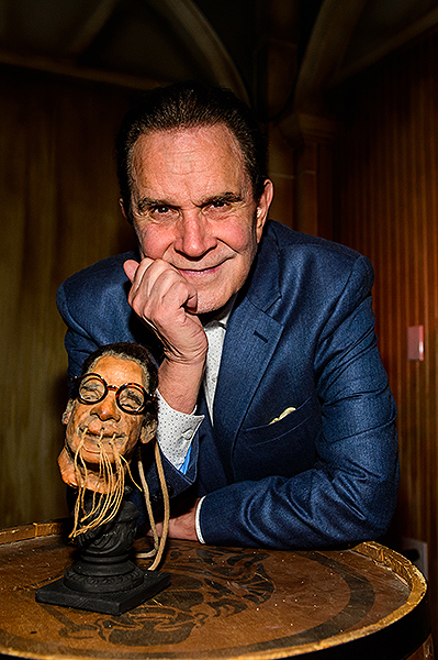 Rich Little and his shrunken head at The Golden Tiki