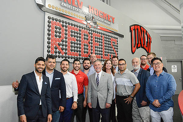 VGK President Kerry Bubolz with UNLV Hockey Staff and Board Members