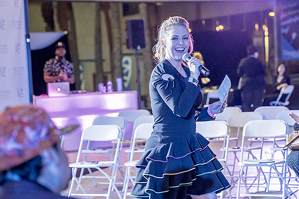 Host Courtney Perna entertains the crowd. Photo Credit Joel Cada