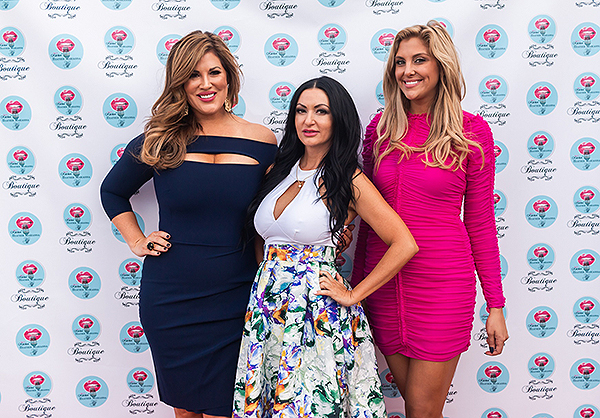 Emily Simpson and Gina Kirschenheiter pose with Beauty Kitchen Boutique owner and TV personality Heather Marianna at grand opening of store