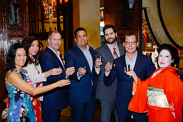Silverton executives toast with Sake to Su Casa