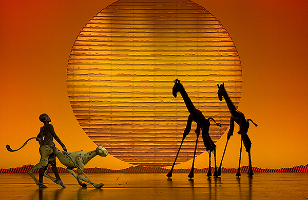 The Cheetah and Giraffes in the opening number The Circle of Life from THE LION KING North American Tour. Disney