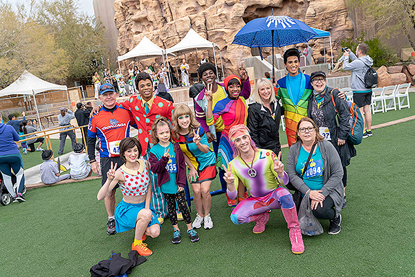 Cirque du Soleil performers pose with Run Away with Cirque du Soleil participants March 2