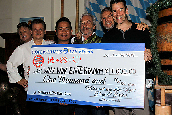 Hofbrauhaus Las Vegas and donation sponsor Prop Peller present pretzel eating contest winner Jeff Civillico with 1000 check April 26