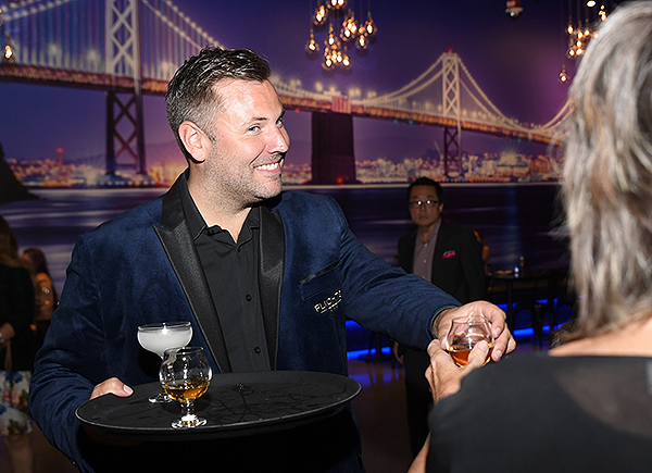 Alex Hult handing out drinks at the grand opening of FLIGHTS Las Vegas