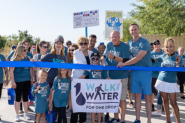 Mayor Carolyn Goodman Jerry Nadal and Brian Kunec cut the ribbon at Walk for Water 2019 Sept. 21