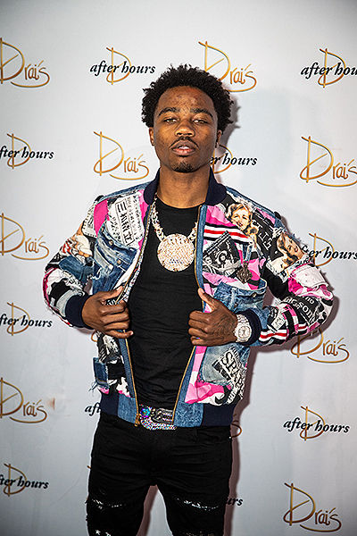 Roddy Ricch poses on the red carpet at Drais Nightclub
