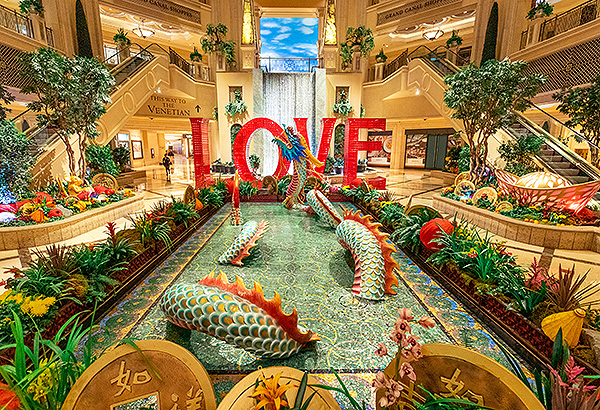A dragon that spans 18 feet adorns the infinity pond in the waterfall atrium at The Venetian Resort Las Vegas