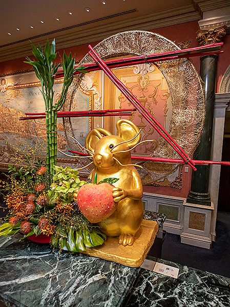 One of nine rats installed throughout The Venetian Resort this one holding a peach in The Venetian Lobby