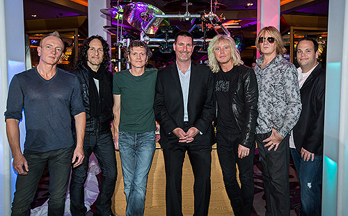 3.21.13 Def Leppard Band Members Pose with Paul Davis of Hard Rock Hotel Casino and Bobby Reynolds of AEG in honor of residency VIVA Hysteria credit Erik Kabik