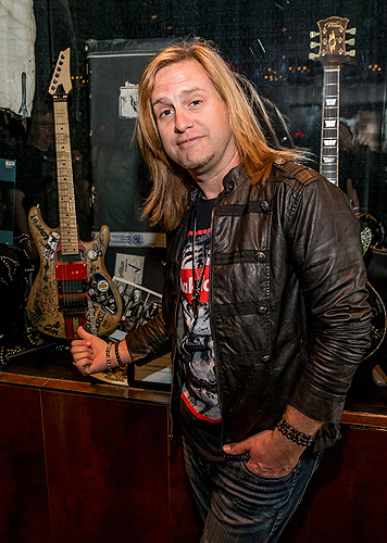 Andrew Freeman from RAIDING THE ROCK VAULT with Wood Graffiti Guitar Credit Erik Kabik