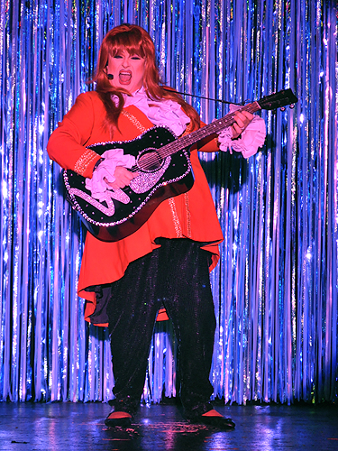 Wynonna impersonator at An Evening at La Cage in the Four Queens