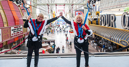 Dawn Newburg and Linda Smith celebrate their zip down SlotZilla 12.2.14 photo credit Tom Donoghue Photography