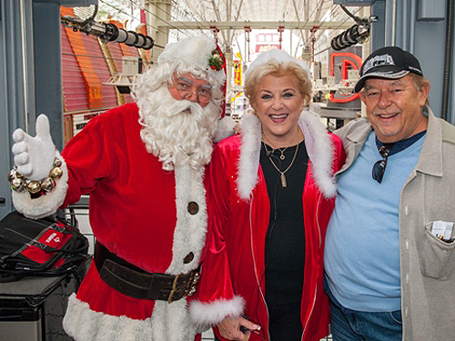 Robin Leach Mayor Goodman and Santa made it across SlotZilla to donate 10000 12.2.14 photo credit Tom Donoghue Photography