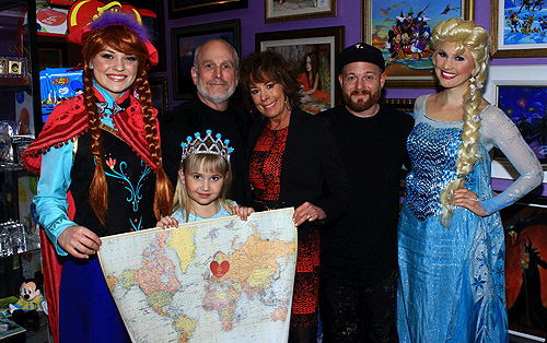 Ariez Black celebrates her wish reveal with Anna and Elsa from Frozen Neil Cantor managing director and Disney artists Paige OHara and Tennessee Loveless