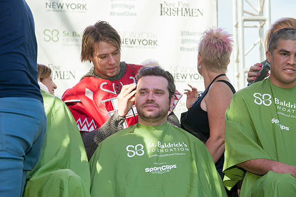 Cast member of TOURNAMENT OF KINGS shaves a head during 8th annual St. Baldricks Day event at New York New York Hotel Casino