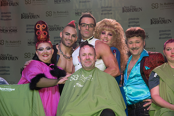 Cast members of Zumanity shave the head of their company manager