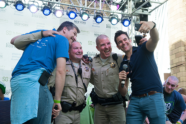 Freshly shaven Las Vegas Metro Police Depatrment pose with James Healy and The Weekend In Vegas host Jeff Civillico