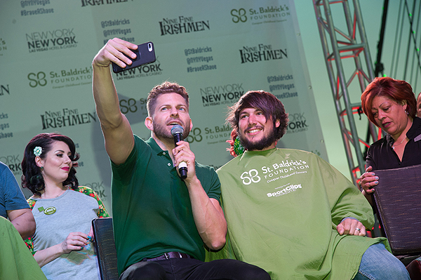 Host of Celebrity Page on OK TV Jaymes Vaughn poses with a shavee during eighth annual St. Baldricks Day head shaving event at New York New York Hotel Casino