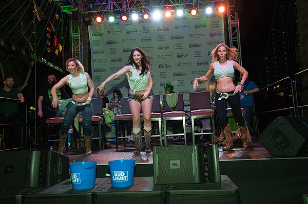 Ladies of Coyote Ugly saloon at New York New York Hotel Casino line dance at eighth annual St. Baldricks Day head shaving event